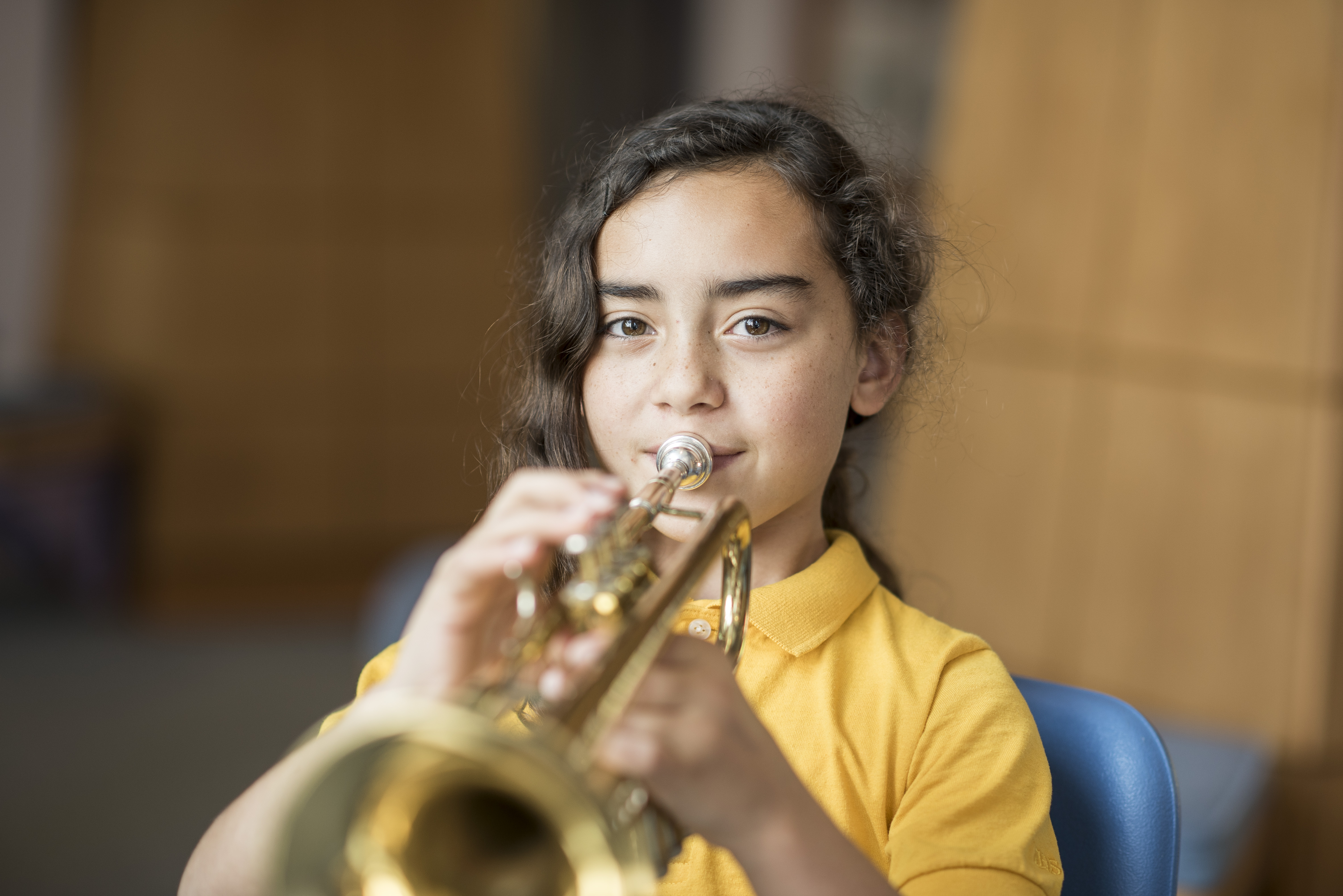 MHS elementary student learning how to play the trumpet.