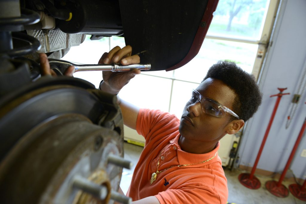 Student working on a vehicle