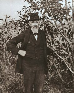 Henry Hershey standing next to one of his quince trees at The Homestead in 1900.
