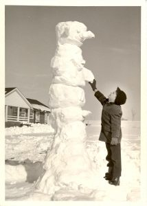 A student getting some snow-related outdoor recreation in February 1964.