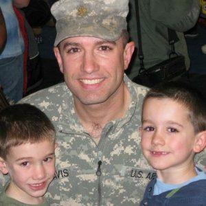 Lt. Col. Paul Davis '94, an MHS alum, with his sons.