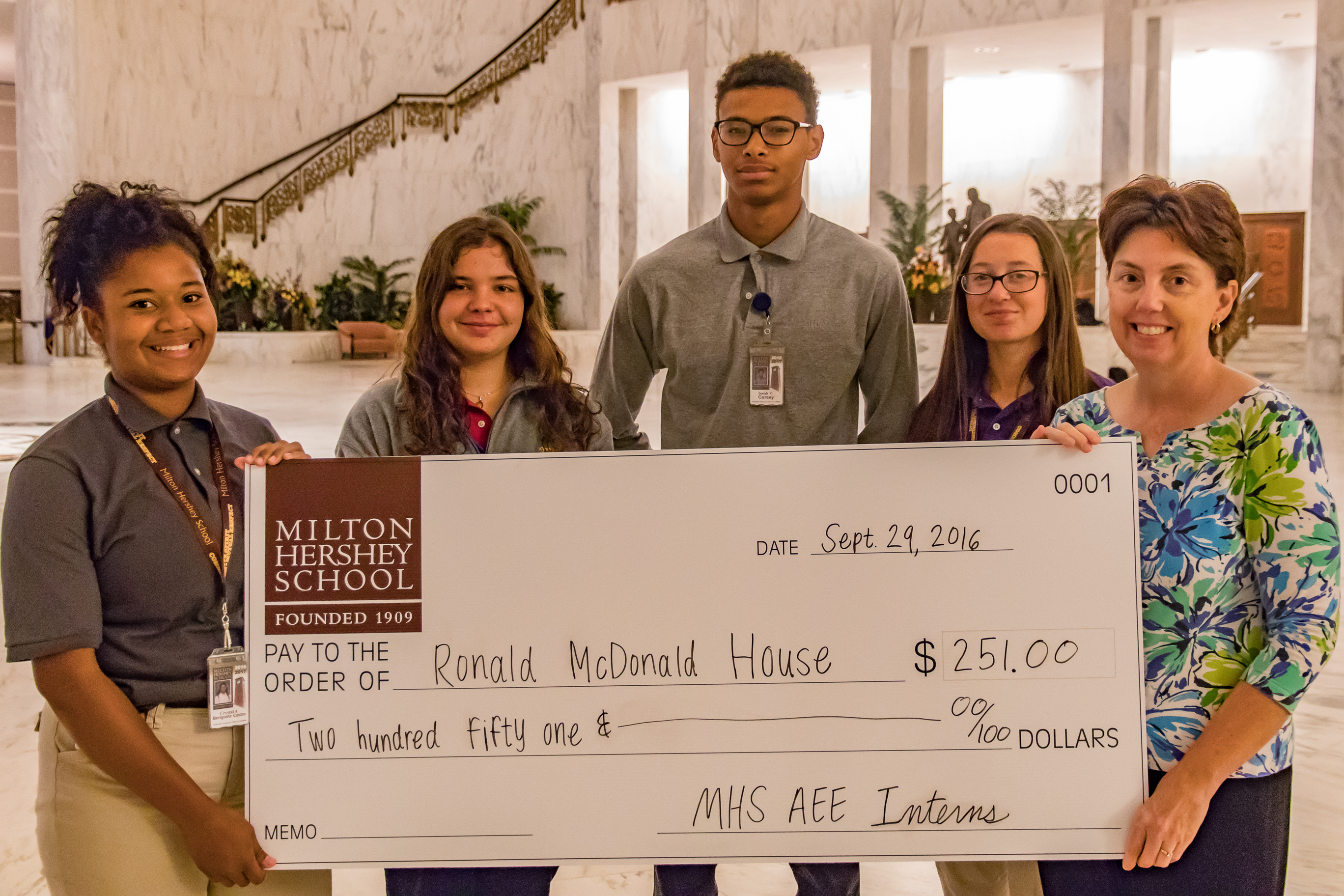 MHS AEE Interns Present Checks to Local Organizations from