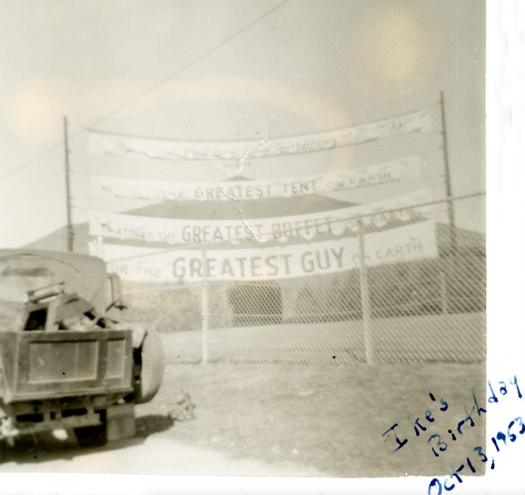 """The sign welcoming visitors to President Eisenhower's birthday party said: """"You are now entering the greatest tent on earth, to attend the greatest buffet on earth, for the greatest guy on earth."""""""