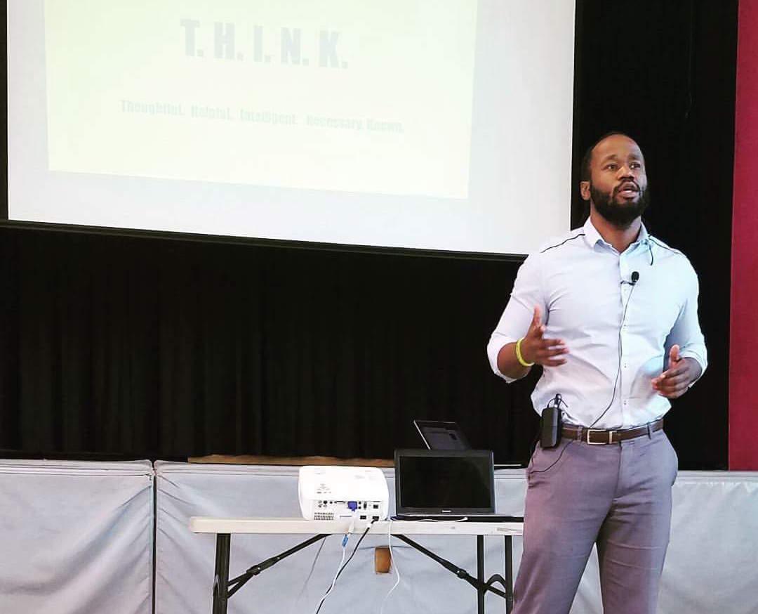 Alphonso Nathan speaking during presentation.