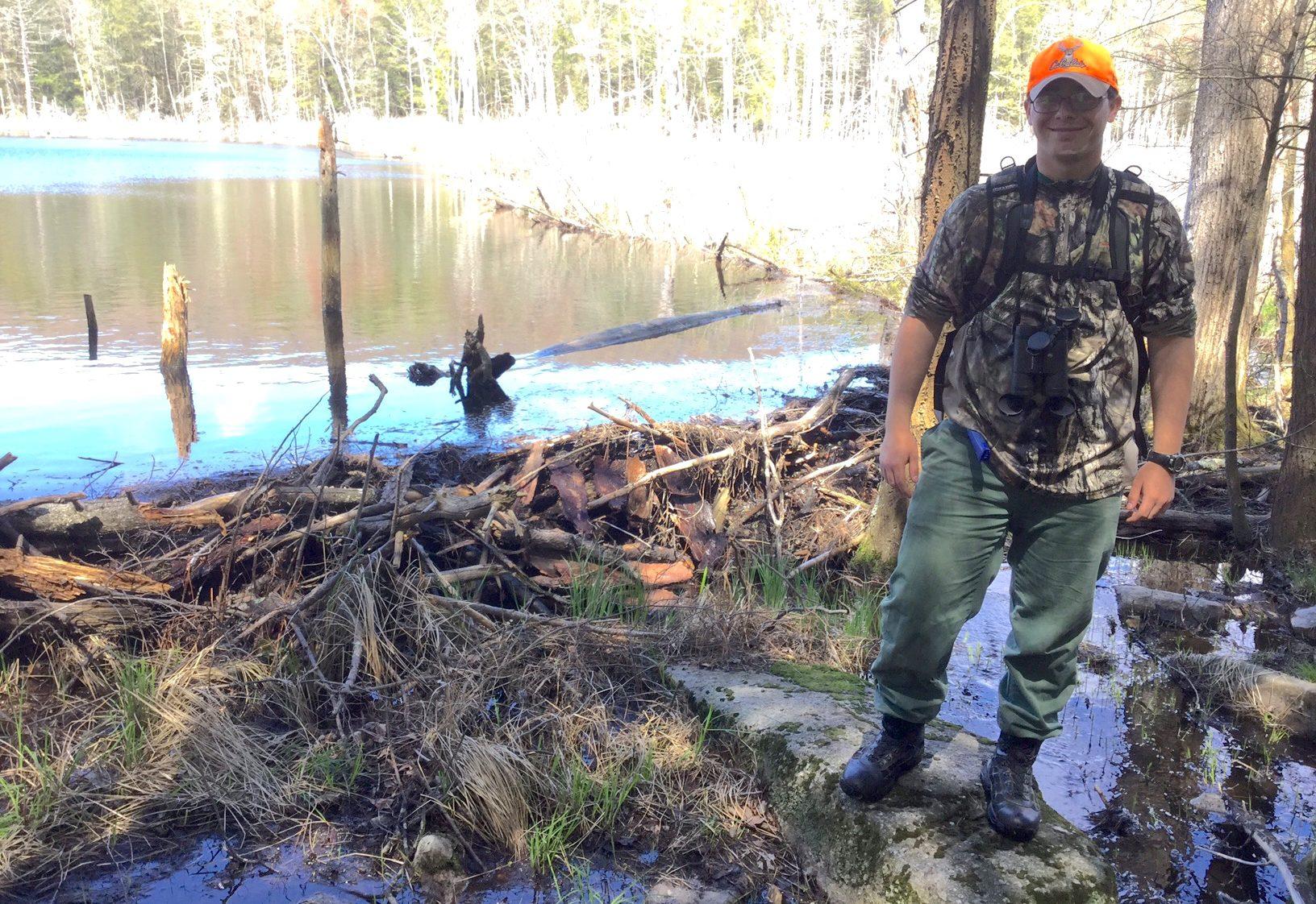 Jordan Edmonds standing near a small body of water.