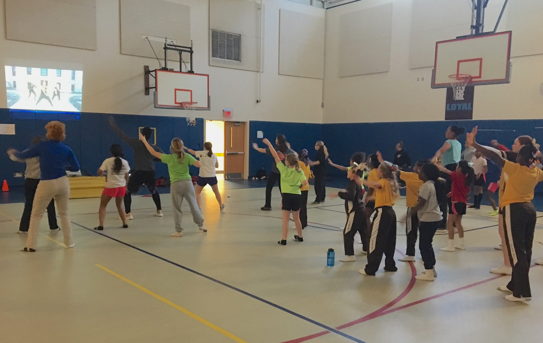 During a weekly Play60 Zumba session, MHS seniors decided to empower the elementary cheerleaders by inviting them into the gym to dance. It soon became a Wednesday tradition.