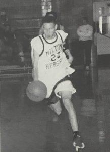 Jonathan Branam running on basketball court.