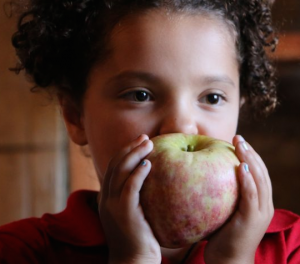 Child eating an apple.
