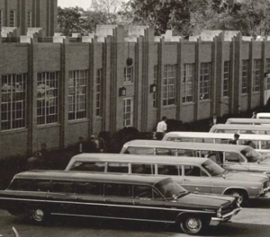 Station wagons in front of school.