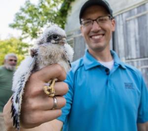 Man holding a bird.