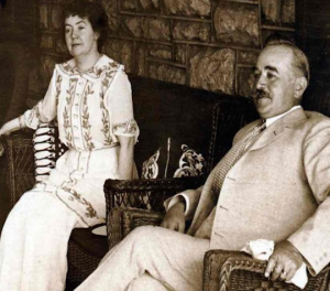 Vintage photo of two people on chairs.
