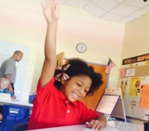 Student raising hand.