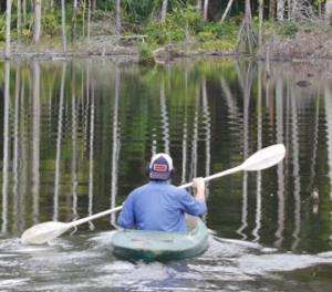 Student kayaking.