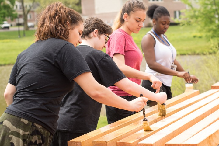 Students painting wood