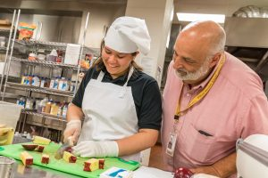 At the end of the 2016-17 school year, 11 eighth-grade students cooked a celebratory meal to thank MHS staff members.