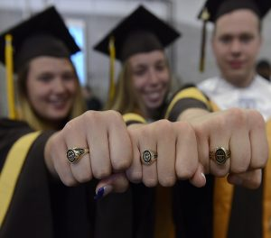MHS graduates showing class rings