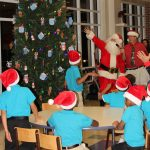 MHS elementary students and alumni celebrating at Christmas party