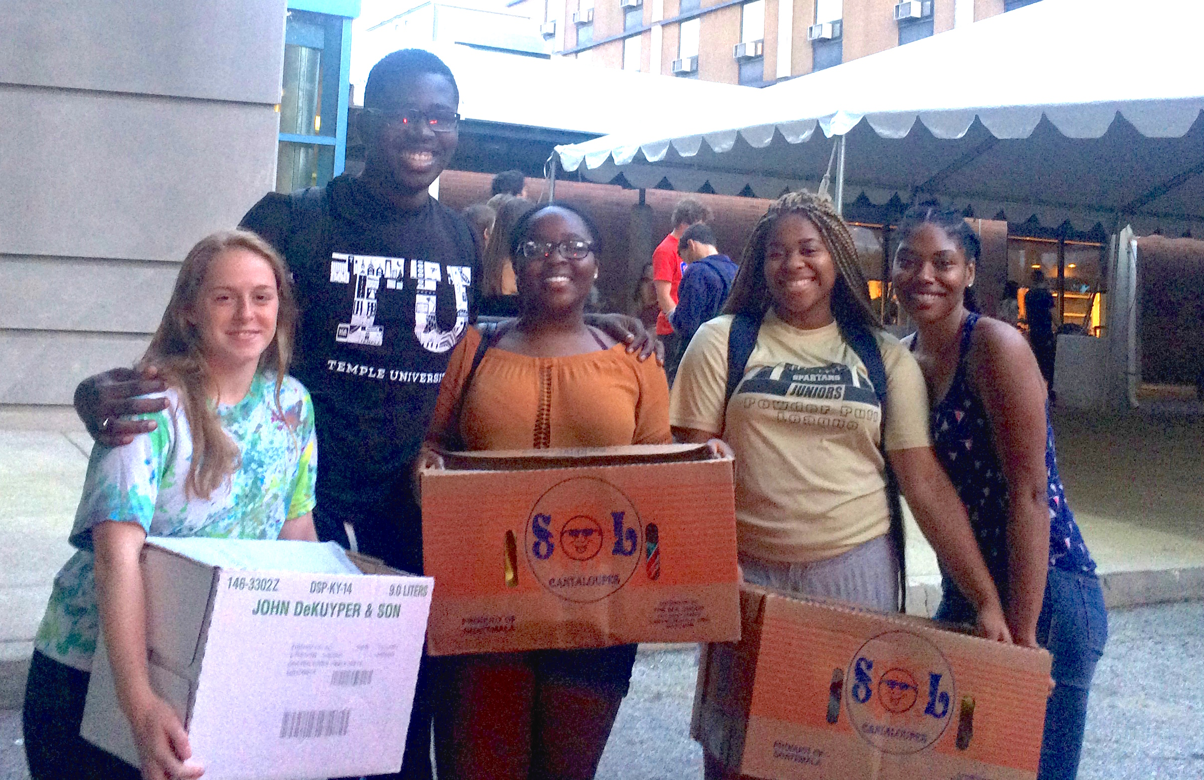 Maya (right) pictured with MHS alumni at Temple University who received her care packages.