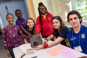 MHS students pose with a rabbit during the CTE Fair