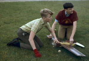 Students making model airplanes during the summer