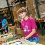 MHS student volunteering at food bank
