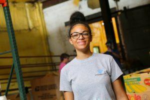 Student volunteering at food bank