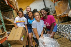 Group of students volunteering at food bank