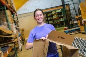 Student helping at food bank