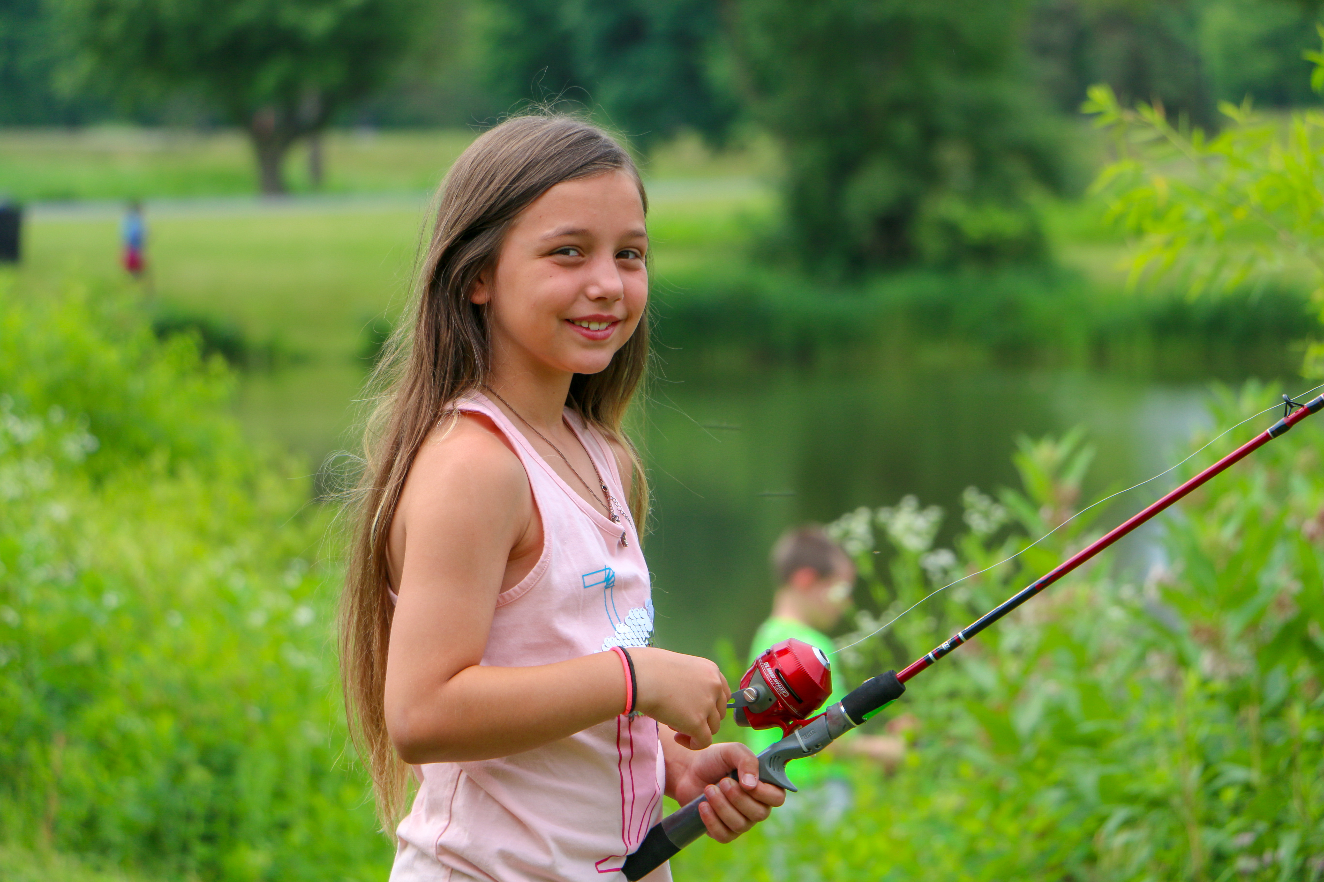 Students fish in Year-Round Experiences program