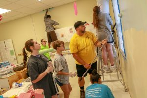 MHS students painting a room in a community center