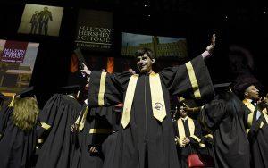 MHS senior celebrates receiving his diploma during Commencement