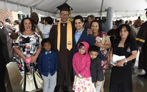 MHS graduate poses with family and friends after Commencement