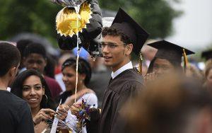 MHS graduate celebrates after Commencement