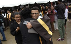 Jared Ross '18 gives a hug after Commencement