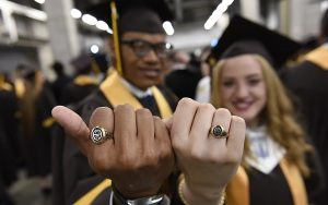 MHS seniors pose with their class rings before Commencement