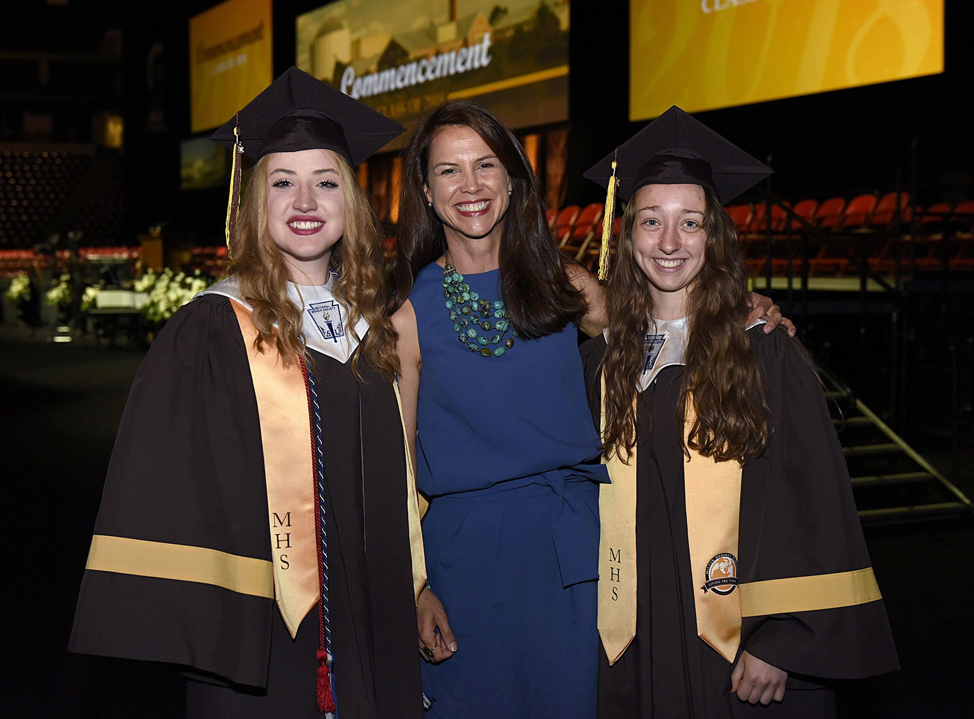 Alumna of the Year Wendy MacClinchy '92 poses with Valedictorian and Salutatorian before Commencement