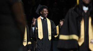 MHS senior smiles at the crowd during Commencement