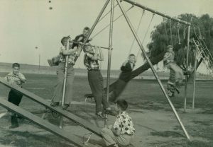 Students playing on the playground during the summer