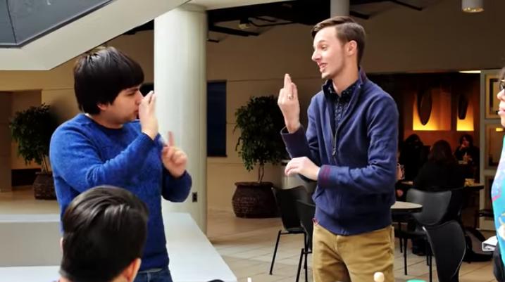 Joshua Arledge '15 using sign language