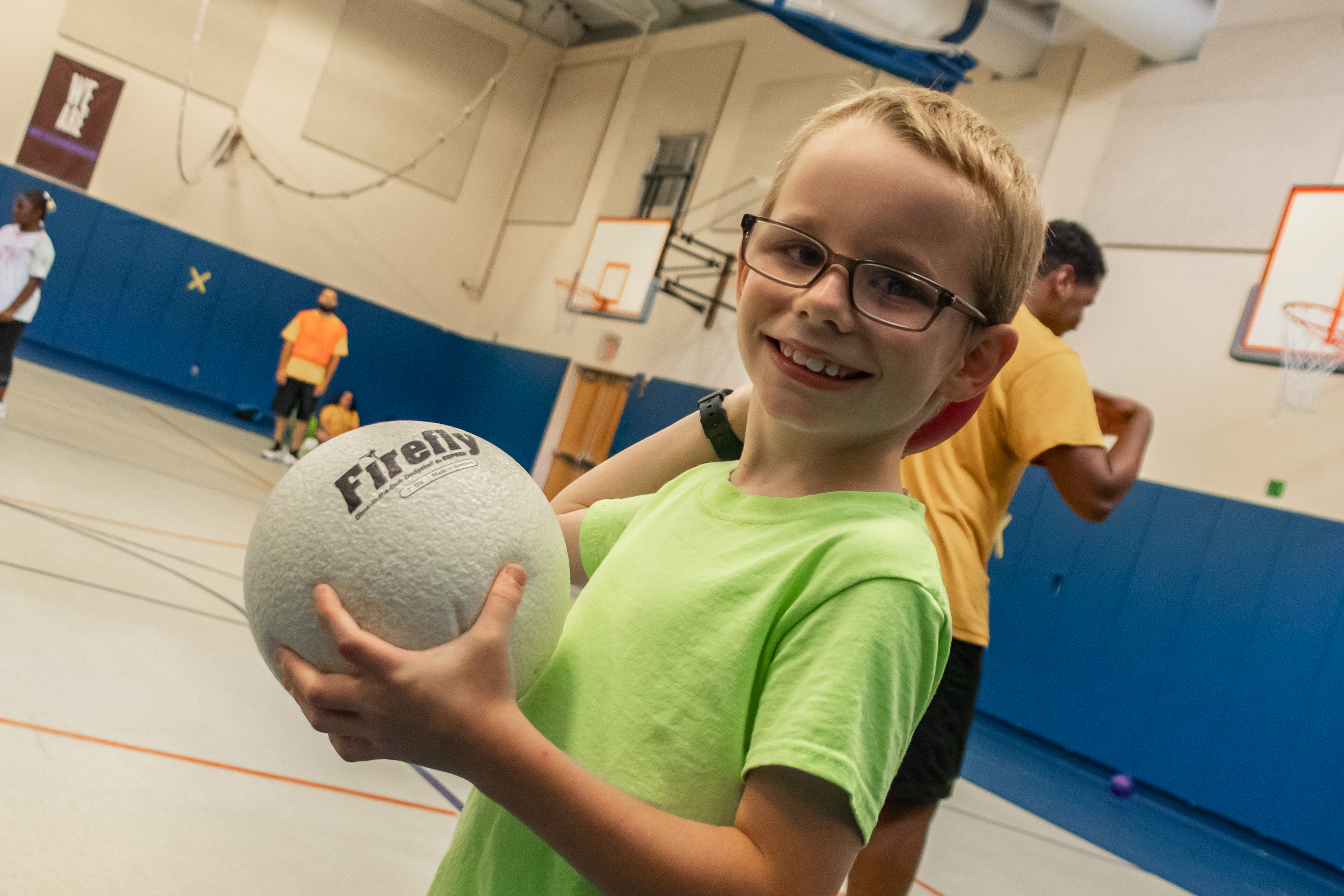 Elementary student playing dodgeball