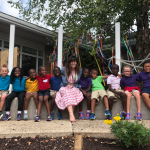 Elementary students pose for a photo in the sensory garden