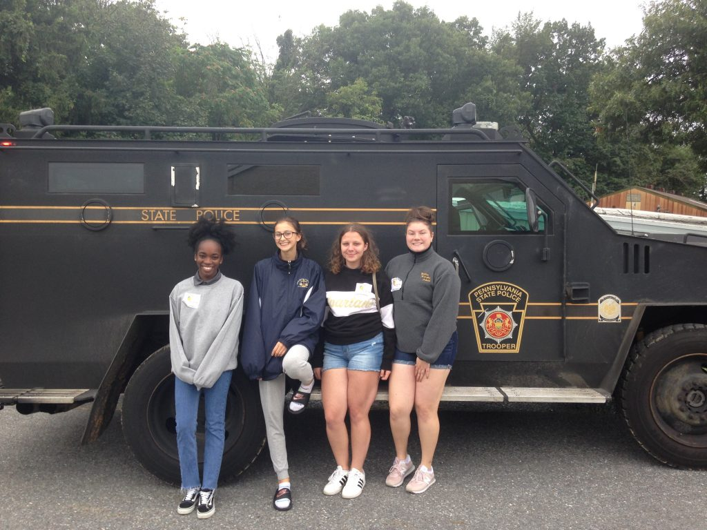 MHS students pose with a Pennsylvania State Police vehicle