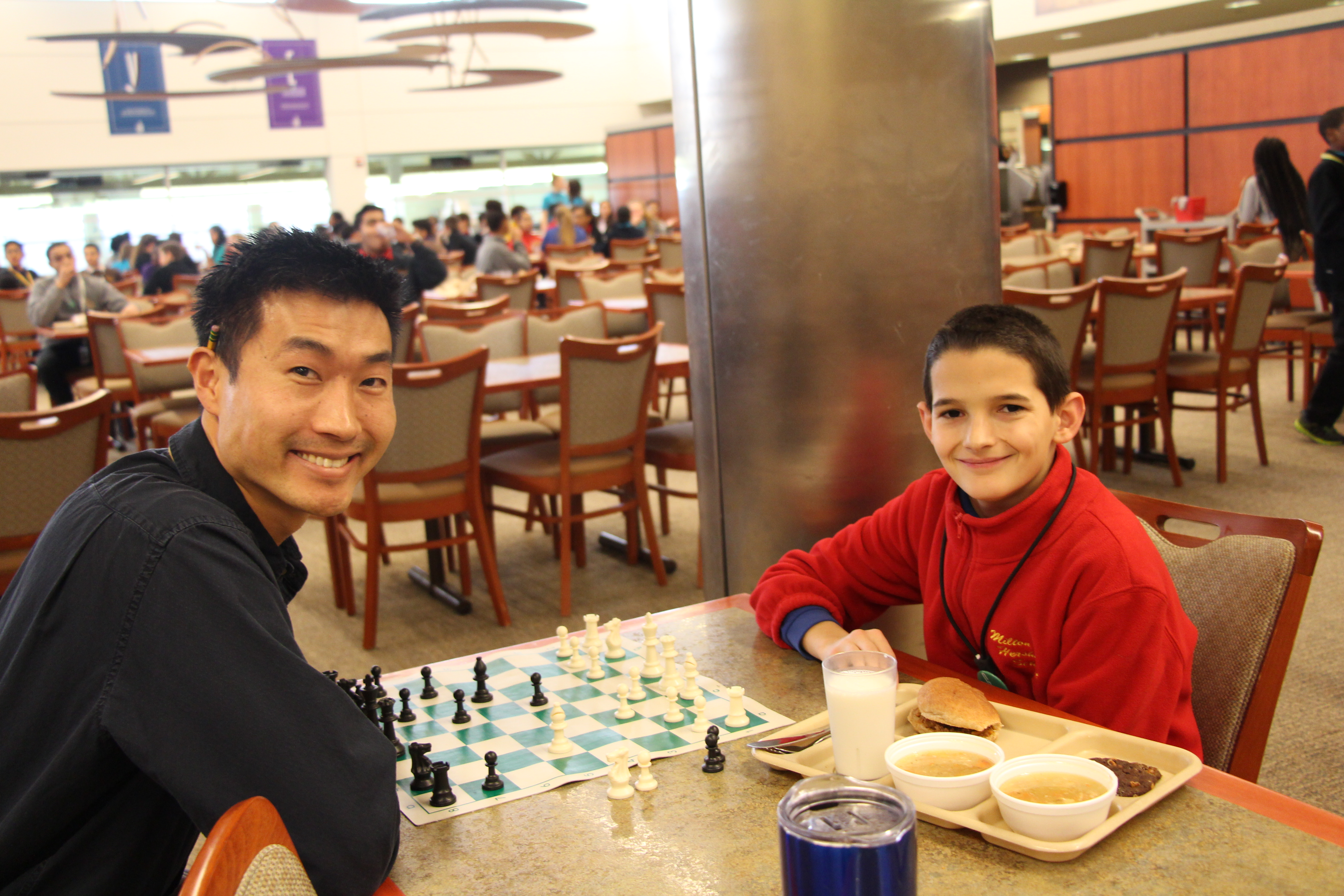 MHS teacher and student playing chess at lunch