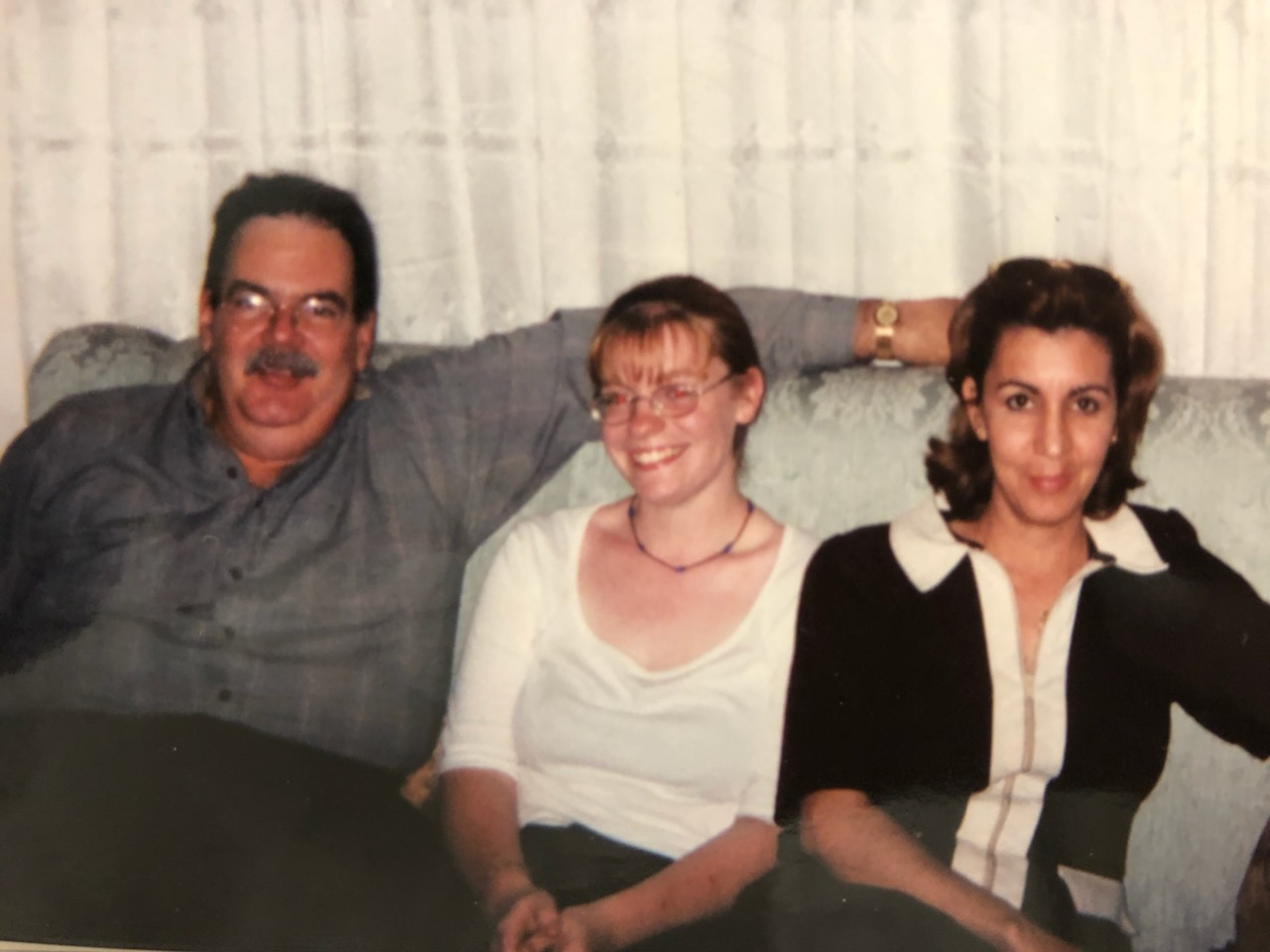 Kimberly with her host parents during her first trip abroad.