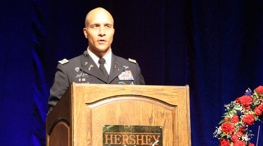 MHS alumnus Lt. Col. Russell Ames '94 addresses students during the annual Memorial Day assembly.