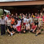 MHS students and chaperones take a group photo with Costa Rican locals