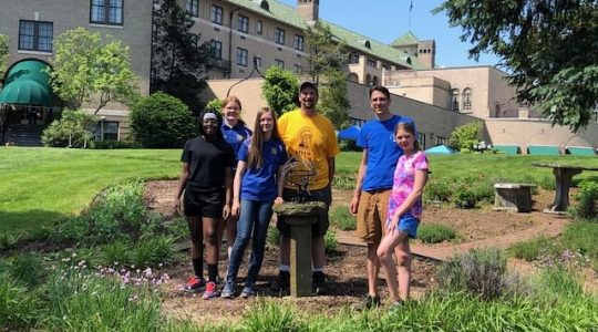 Hershey Project Pathways Program participants pose for a photo in the newly-planted herb garden.