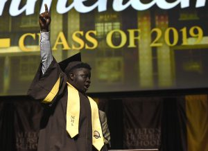 A member of the MHS Class of 2019 celebrates on stage after receiving his diploma.