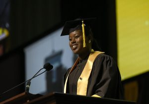 MHS senior Janet-Nicole Riddick gives the farewell address during the 85th Commencement Ceremony.