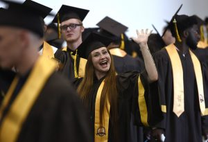 A member of the MHS Class of 2019 waves to the camera before the start of the 85th Commencement Ceremony.